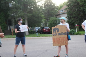 Protesters gather outside City Council Member Linea Palmisano's Linden Hills home
