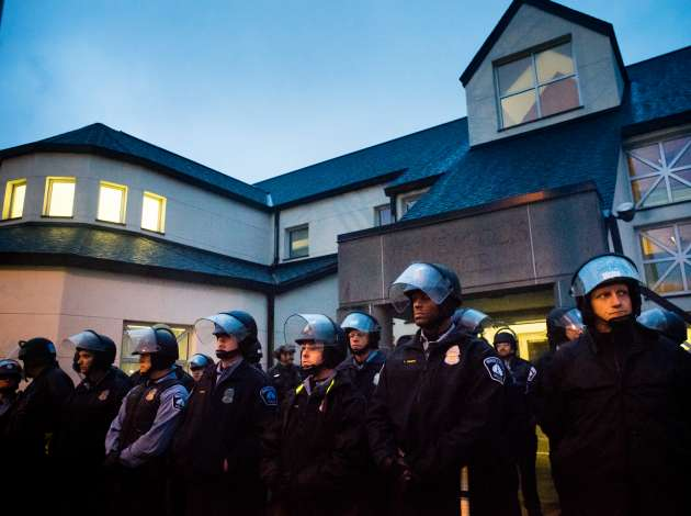 Officers guard the 4th Precinct in mid-November as protesters condemned the police shooting of Jamar Clark. File photo by Annabelle Marcovici